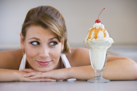 Woman looking at ice-cream sundae.